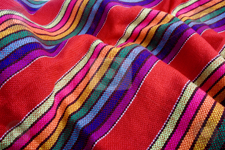 Mexican traditional fabric stock photo, Close up of mexican colorful traditional fabric by iodrakon