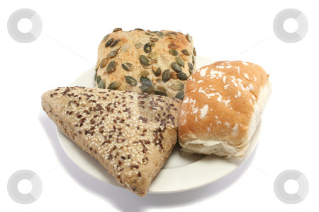 Three Bread Rolls stock photo, Sesame seeded, pumpkin seed and plain white bread rolls on a plate by Helen Shorey