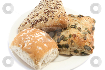 Bread Roll Selection - Closer stock photo, Sesame seed, pumpkin seed and plain white rolls on a plate by Helen Shorey