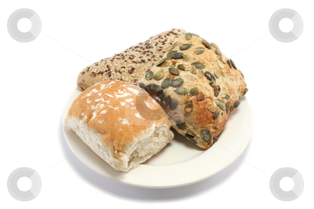 Selection of Bread Rolls stock photo, Plain white roll, pumpkin seed granary roll and sesame seeded wholemeal roll on a plate by Helen Shorey
