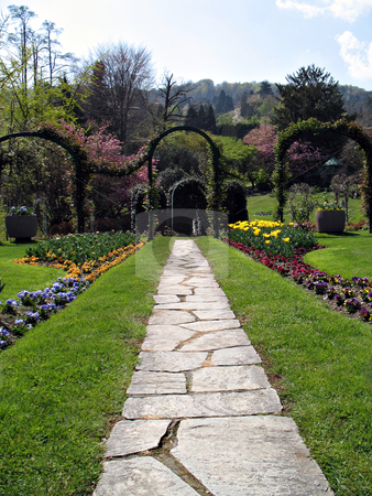 Walk in the garden stock photo, Pathway in a marvellous garden reach of flowers and trees. Lago Maggiore, Italy by Roberto Marinello