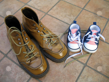 Mother and daughter shoes stock photo, A pair of shoes for the mother and a pair for the little daughter by Roberto Marinello