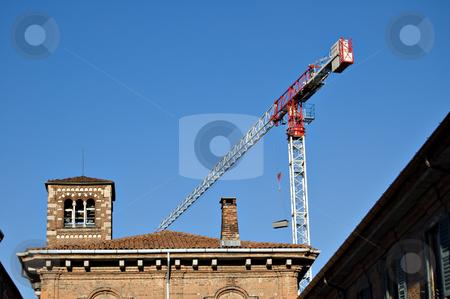 House renovation with jib crane stock photo, Building yard with jib crane for house renovation by Roberto Marinello