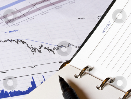 Falling finance graph and a notepad stock photo, Closeup of an opened agenda to a blank NOTES page.  An economic decreasing chart and analysis business histogram is present in the background. by FEL Yannick