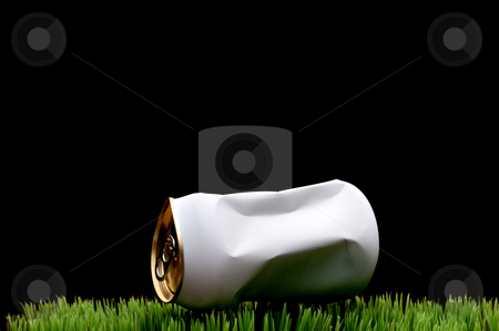 A horizontal image of a white crushed soda can tossed on green g stock photo, A horizontal image of a white crushed soda can tossed on green grass instead of being recycled by Vince Clements