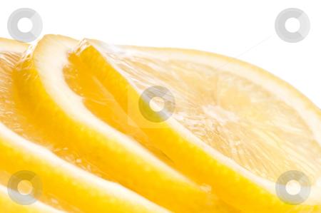 A tilted horizontal macro of juicy fresh cut lemon slices. stock photo, A tilted horizontal macro of juicy fresh cut lemon slices. by Vince Clements