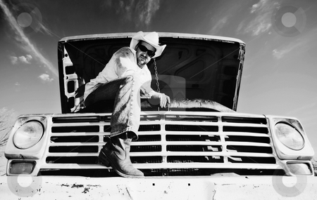 Man under the hood of his truck stock photo, Man in cowboy hat under the hood of truck by Scott Griessel