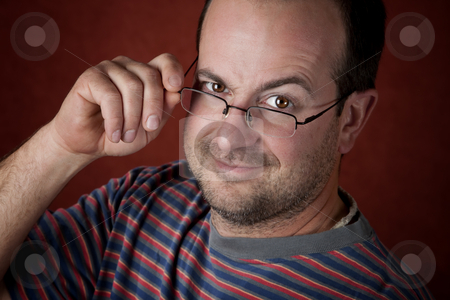 Regged young man wearing glasses stock photo, Rugged young man with beard stubble wearing glasses by Scott Griessel
