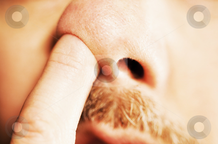 Man's finger in nose stock photo, Extreme close-up of man's finger in his nose by Bryan Mullennix