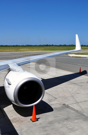 Air transportation: Jet engine and wing detail stock photo, Commercial airliner: wing and engine detail. by Fernando Barozza