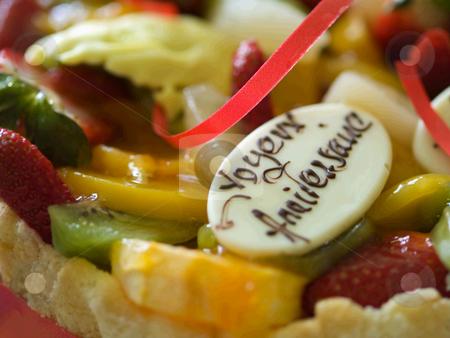 Birthday cake with exotic fruits  stock photo, Closeup of a birthday cake with exotic fruits : kiwi, strawberry, orange, mango.