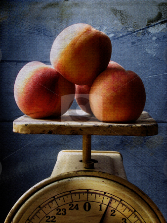 Peaches stock photo, Peaches on scale in grunge background by R Deron