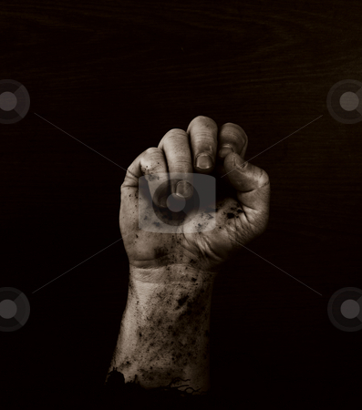 Fist of Dirt stock photo, Fist in quadtone with grain antique grunge effect by John Teeter