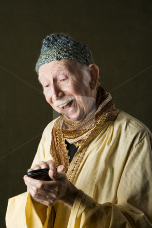 Cell Phone Guru stock photo, Wise Man with Knit Cap Using Cell Phone by Scott Griessel