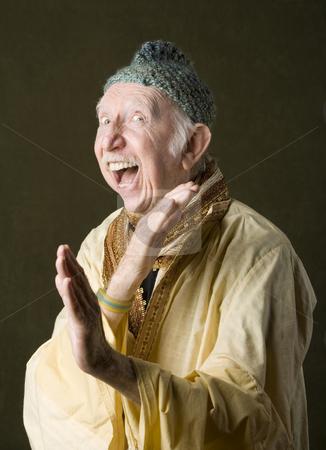 Guru defending himself stock photo, Wise guru using martial arts to defend himaself by Scott Griessel