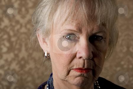 Skeptical Senior Woman stock photo, Closeup portrait of skeptical senior woman with bright lipstick by Scott Griessel