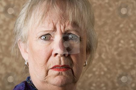 Horrified Senior Woman stock photo, Closeup portrait of horrified senior woman with bright lipstick by Scott Griessel