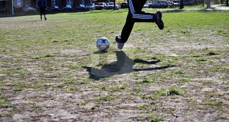 Football stock photo, Man kicks the ball by Leyla Akhundova