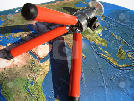 Ready to travel stock photo, Planning a tour around the world, atlas map and tripod by Roberto Marinello