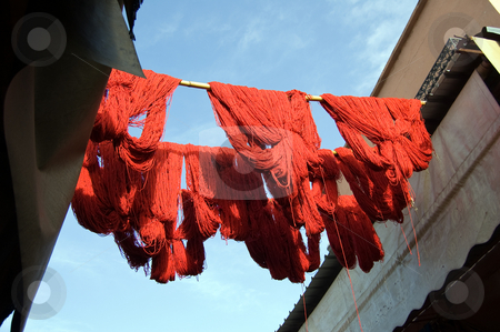 Marrakesh Red wool drying stock photo, Red wool just tinted is drying in the souq of Marrakesh by Roberto Marinello
