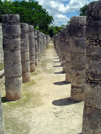 Chichen itza collonade stock photo, Ruins of a colonnade in maya city chichen itza by Roberto Marinello