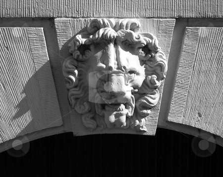 Stone lion head carving stock photo, Stone lion head carving on the facade of a building in Amsterdam by Jaime Pharr