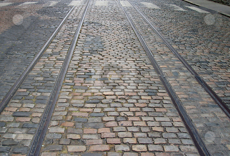 Tracks in a cobbled street stock photo, Disused rail tracks in a cobbled street, Dublin by Jaime Pharr