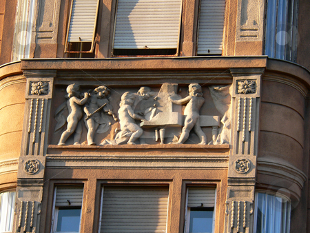 Wall sculpture stock photo, A building in Budapest decorated with a sculpture depicting musicians in concert by Casinozack