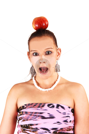 An very scared woman. stock photo, A young woman with an apple on her head is very scared what is soon happening to her. by Horst Petzold