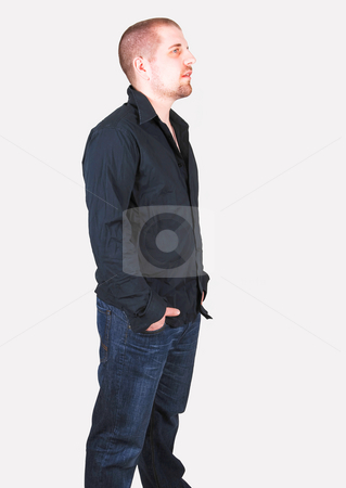 Young man standing. stock photo, A young man standing in the studio for some portrait shoots. by Horst Petzold