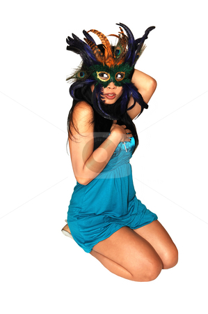 Happy woman with a mask. stock photo, Close-up portrait of a young Asian girl with a colorful mask. by Horst Petzold