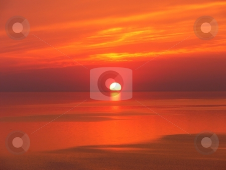 Sunrise over the lake   stock photo, The sun rises early in the morning over lake Ontario. by Horst Petzold