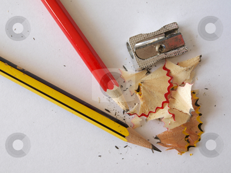 Pencils and a sharpener.  stock photo, Pencils after sharpening with some new shavings. by Ian Langley