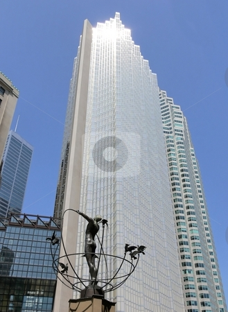 Sky scraper  stock photo, A sky scraper in Toronto with sun reflection on top and blue sky. by Horst Petzold