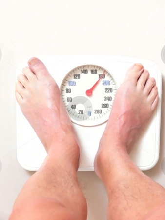 Man on scale    stock photo, A man on the bathroom scale finds hi is to heavy and needs to loose weight. by Horst Petzold