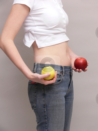 Young girl   stock photo, Young girl is proud of her weight loss and flat tummy. by Horst Petzold