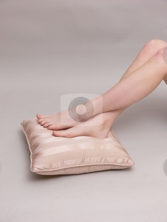 Bare feet     stock photo, Young girl rest her bare feet on a pillow on the floor. by Horst Petzold