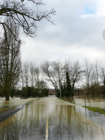 Flooded Road stock photo, Witham, Essex, UK - 10 Feb A small river has burst its' banks and flooded the riverside footpath and nearby roads. Unusual for Essex as we are the driest UK county. by Helen Shorey