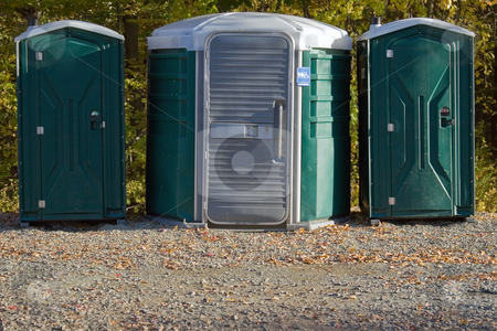Porta Potties stock photo, Some portable toilets located on the wooded hiking trail. by Todd Arena