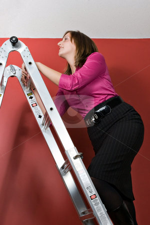 Climbing The Corporate Ladder stock photo, A young business woman rising to the top of this symbolic corporate ladder. by Todd Arena