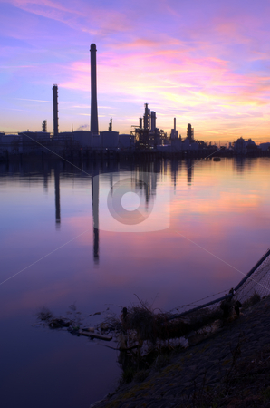 Oil Refinery Sunset stock photo, An oil refinery, situated in a commercial harbor, during a radiant sunset. HDR  image by Corepics VOF