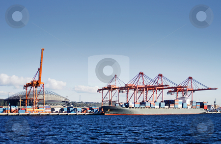 Seattle container terminal stock photo, View on the seattle container terminal, seen from the water with a sports stadium in the background by Corepics VOF