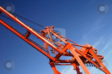 Crane 2 stock photo, Details of a huge container crane against a blue sky by Corepics VOF