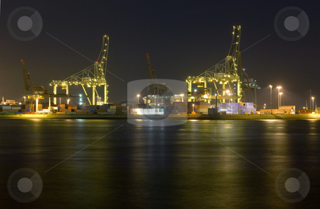 Rotterdam Harbor at Night stock photo, An overview of the Rotterdam Container harbor, with its huge cranes, stacked containers and industrial activity at night. Business continues 24/7 by Corepics VOF