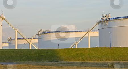 Oil tanks in the evening light stock photo, Oil tanks in the evening light by Corepics VOF