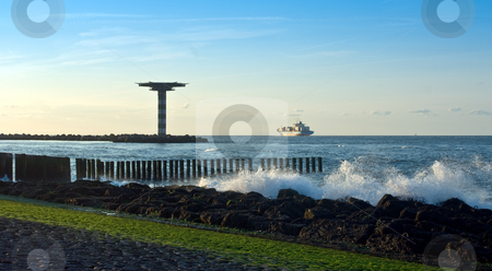 Leaving port stock photo, A container ship leaving port on a tranquil evening, sailing past a helicopter platform by Corepics VOF