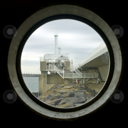 Through view on the barrier stock photo, A through view on the storm flood barrier through one of the windows of the visitors' centre by Corepics VOF