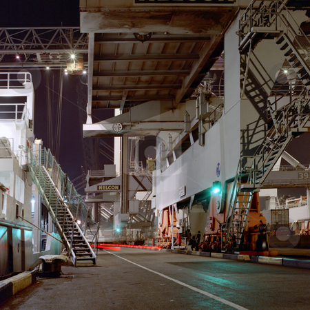 Dock at night stock photo, Container terminal activity at night. by Corepics VOF