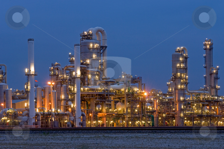 Petrochemical Industry stock photo, A petrochemical plant, with it's stainless steel cylinders, it's valves, chimneys, pipes, tubes and construction artificially lit just before the break of dawn by Corepics VOF