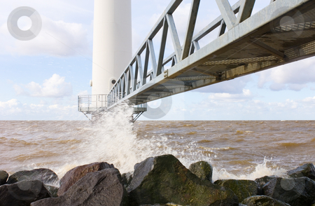Wind turbine jetty stock photo, The jetty leading towards the entrance of a wind turbine just off the coast. by Corepics VOF